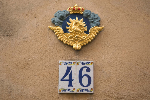 Phoenix-on-Gamla-stan-street.jpg - The symbol of a phoenix above a doorway in Stockholm indicates the house is insured.