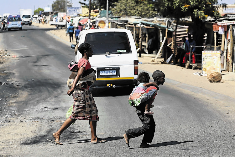 Diepsloot residents go about their business. Picture: THE TIMES