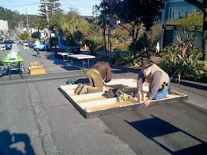 Photo: Preparation: Project volunteers constructing a stage for the opening celebration (Saturday, December 7, 2013) for the Hidden Garden Steps (16th Avenue, between Kirkham and Lawton streets in San Francisco's Inner Sunset District); Steps organizing committee member Gilbert Johnson is working on the right side of the structure.  For more information about the Steps, please visit our website (http://hiddengardensteps.org), view links about the project from our Scoopit! site (http://www.scoop.it/t/hidden-garden-steps), or follow our social media presence on Twitter (https://twitter.com/GardenSteps), Facebook (https://www.facebook.com/pages/Hidden-Garden-Steps/288064457924739) and many others.