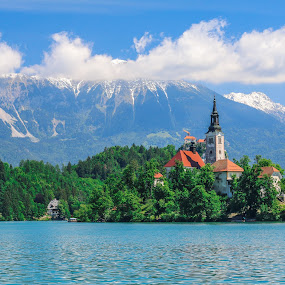 Bled island by Mario Horvat - Landscapes Waterscapes ( water, clouds, church, lake, landscape, island, mountains, blue sky, nature, snow, slovenia, bled, alps,  )