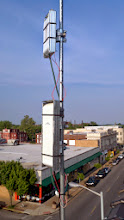 """Photo: A Nanostation M5 and Nanostation M2 Loco hung on a mast fashioned from 1/2"""" EMT conduit, with improvised shielding."""