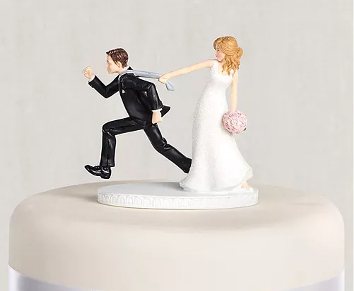 tie-puller bride and groom topper
