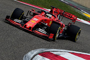 Ferrari's Sebastian Vettel topped the timing sheets in the first practice session for the Chinese GP.