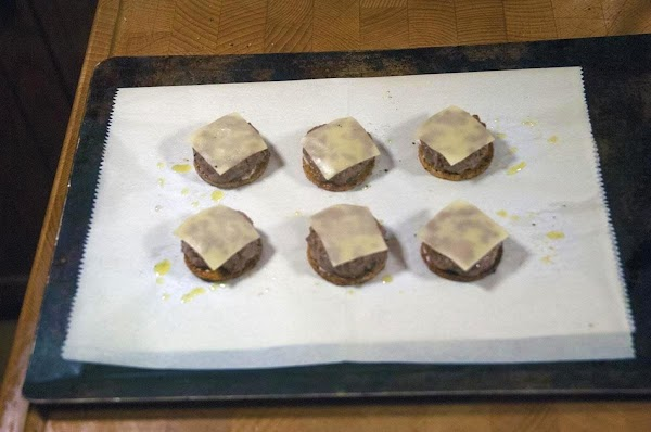 Place the burgers on top of the potato rounds, and then top with a...