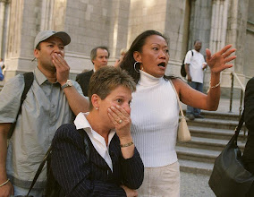 Photo: People react to the scale of destruction left in the wake of the 9/11 attacks in New York. (AP)
