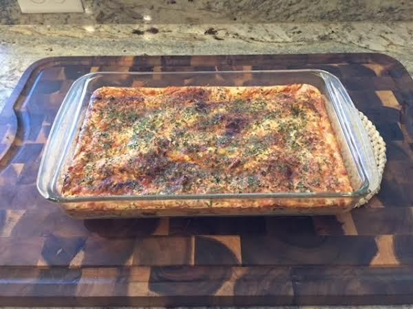Bountiful Brunch Casserole Is Cooking On A Handmade Cutting Board.