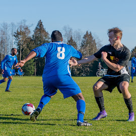 Moving Past Defense by Garry Dosa - Sports & Fitness Soccer/Association football ( running, ball, soccer, sports, outdoors, blocking, action, males, people, movement, sport )