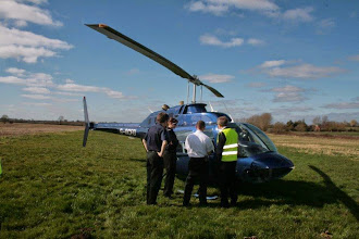 Photo: Captain Phil familiarises the fire crew with the helicopter