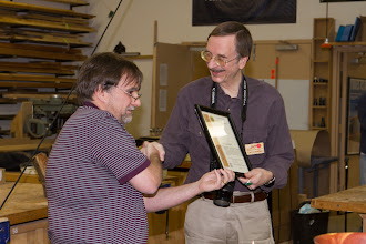 Photo: Tim presents outgoing Program Chair Gary Guenther with a Certificate of Appreciation for his contributions to MCW.