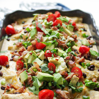 Bacon and Eggs Breakfast Enchiladas with Easy Cheese Sauce