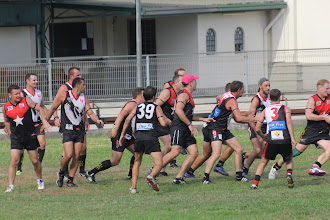 Photo: Congested footy. Photo by Anne-Marie Robb.