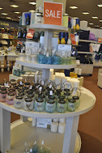 Photo: And I took a quick look at the great house ware items, I was very tempted by all those sale signs.  I love the colourful glass lanterns.