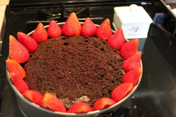 Slice 1-1/2 pints of strawberries in half, thinly slice the rest.  Place a...