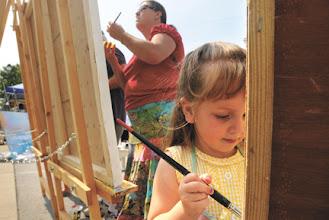 Photo: Working on Community Murals