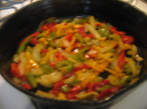 Place the Tablespoon of  olive oil in a skillet over medium heat; add...