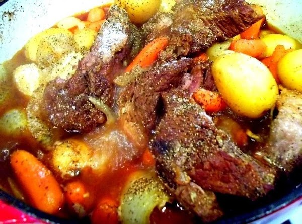 Continue to simmer, covered, until the meat is tender, about an hour and a...