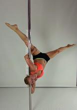 Photo: Aleksandra Deren - Backward Forearm Press and Corner Elbow Hold with Straddle leg Line - Vertical Pole Gymnastics at Pole Fitness Studios Sydney Australia