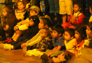 Photo: Kids watching street perfomers after dark