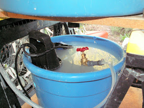 Photo: Sump pump and hose to feed water to the sprayer.