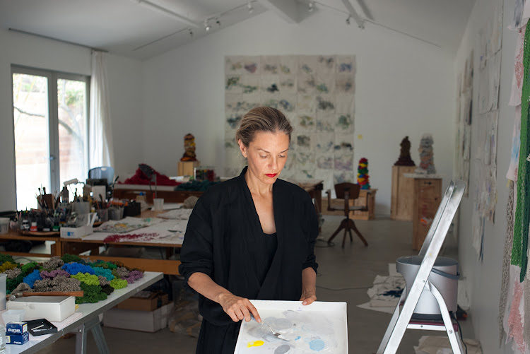 Liza Lou at work in her studio.