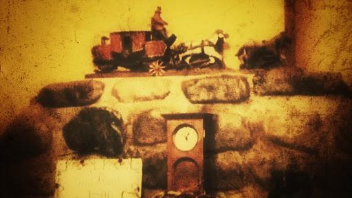 Figura de la carreta del diablo sobre chimenea