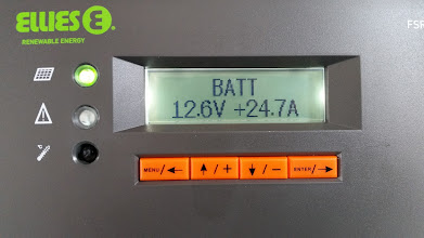 Photo: [Device replaced with a Victron unit now] Battery voltage has risen to 12.6V by 13:20 and is receiving 24.7A with the sun shining. Low voltage this morning was 11.4V just after 09:30.