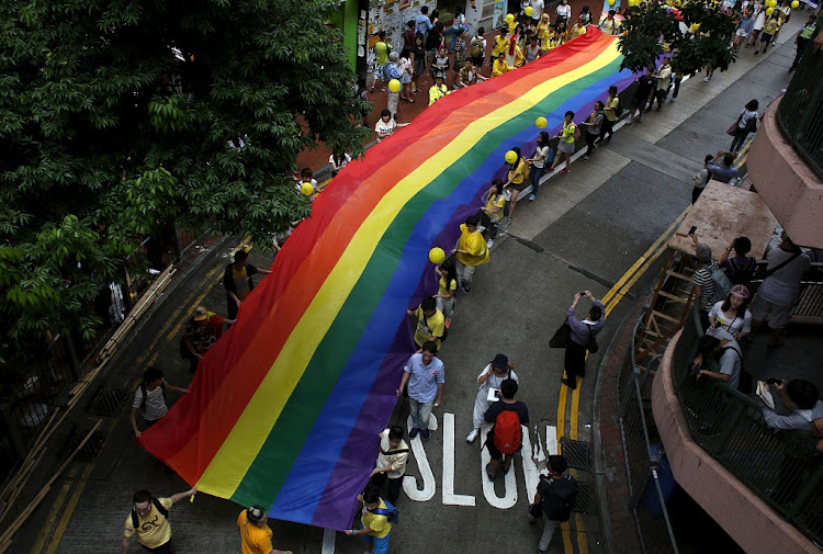 Participants march with a banner with rainbow colours during the annual pride parade in Hong Kong, November 7 2015. Picture: REUTERS/ BOBBY YIP