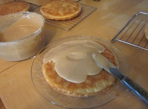 To assemble: Place 1 cake round on serving platter. Spread about 1/4 cup frosting...