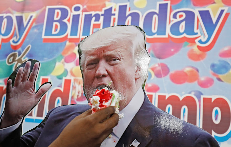A member of Hindu Sena, a rightwing Hindu group, celebrates U.S. President Donald Trump's birthday in New Delhi on Thursday.