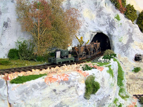Photo: 016 Tom Snook has added a complete new board with a mining scene to Stoney Middleton. A simplex loco emerges from an adit with a train of skips in this photo