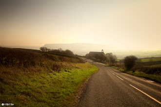 Photo: The Chapel On The Hill  My wife and I spent a weekend in Whitby and decided to drive across to a place called Robin Hoods Bay, it was a foggy day and although cold the sun gave the fog a warm glow. As we came down this hill I saw the small chapel sat just on the bend and had to stop to take this photograph.  Sometimes you have to hunt for the right location, sometimes it just finds you.