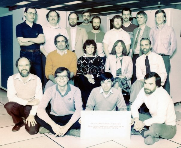 Photo: SFU IBM 3081 Computing Installation Team Mike Dustan, Doug Davey, Bob Spratt, George Lindholm, Charlie Bennet, Bruce Cowan, Peter Howard, Monique Indra, Steve Spears, Chao Cheng, Dale McGladdery, Margaret Sharon, Bob Gottscalk, Ken Ladds, Hugh Pretty, Ian Williams, Steve Kloster Copied from George Lindholm's Facebook Photos