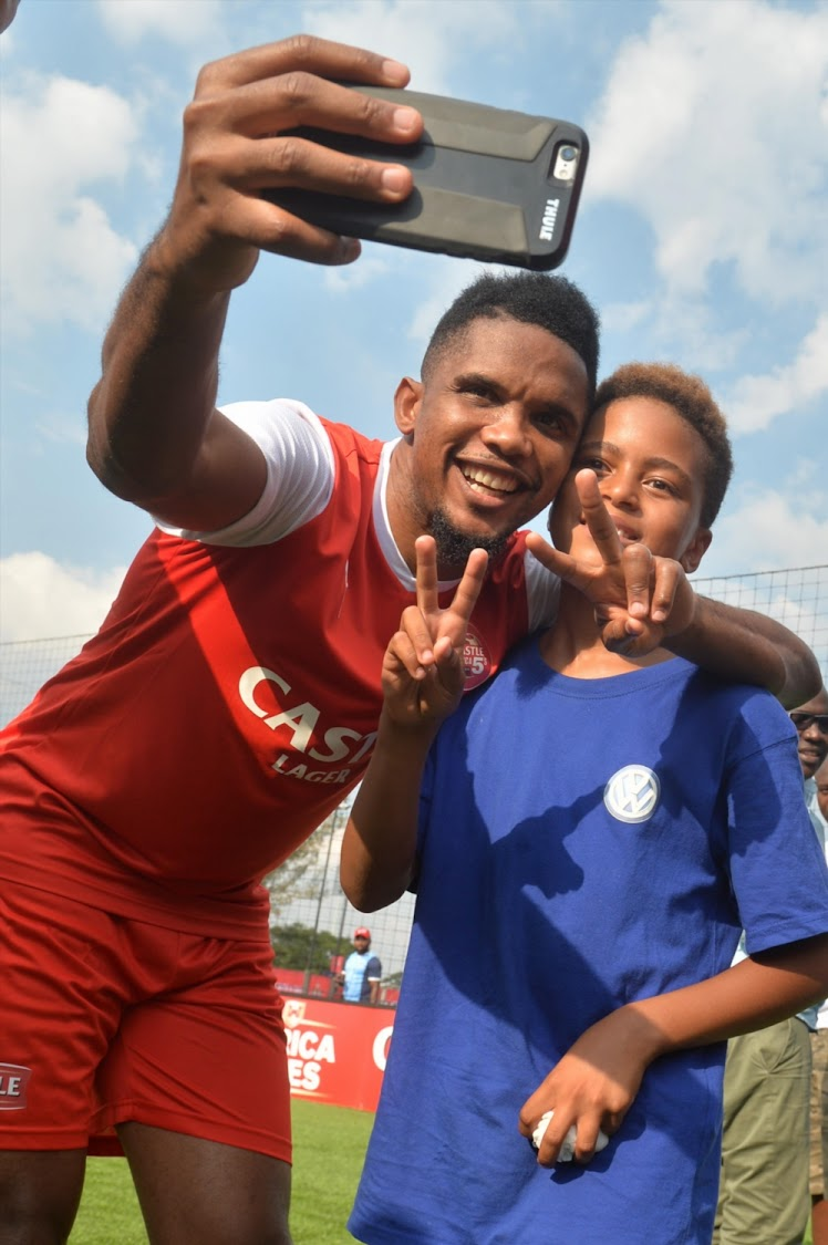 Samuel Eto'o Fils is a Cameroonian professional footballer with Football legend Mark Haskins son Mikael Haskins during the Castle Africa 5's Media Launch at Dicovery Soccer Park on January 11, 2018 in Johannesburg, South Africa.