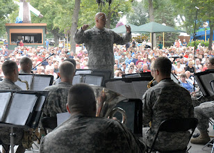 Photo: Chief Warrant Officer Trygve Skaar directs the 34th Red Bull Infantry Division Band during their performance at the Minnesota State Fair's Military Appreciation Day Aug. 30, 2011 in St. Paul, Minn.