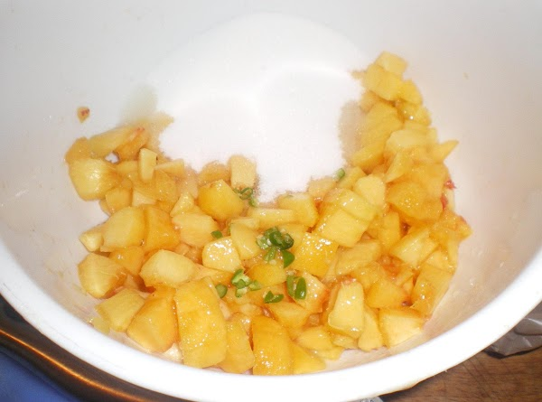 In a medium bowl combine diced peaches, minced peppers, sugar and lemon juice.