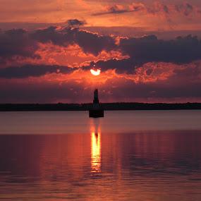 The Escanaba Morning Sun  by Jason Asselin - Landscapes Sunsets & Sunrises ( skyline, lighthouse, lake, sunrise, sun )