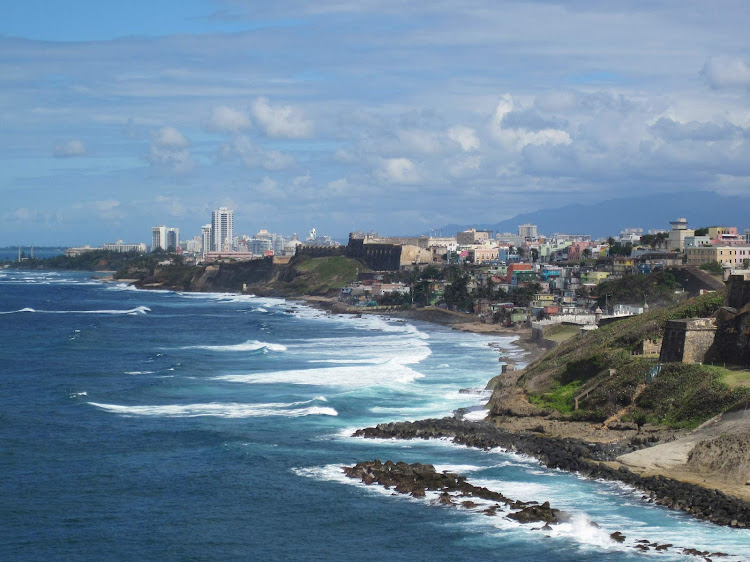 The beautiful coastline of San Juan as a cruise ship approaches Castillo de San Cristobal.