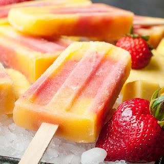 Tropical Mango Pineapple Strawberry Swirled Fruit Pops.