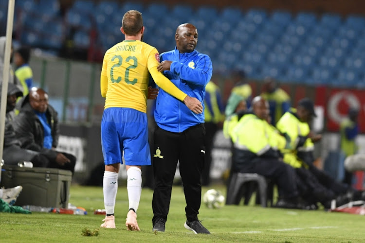 Mamelodi Sundowns coach Pitso Mosimane hugs striker Jeremy Brockie during their 3-1 Absa Premiership win over Free State Stars at Loftus Versfeld in Tshwane on November 7, 2018.