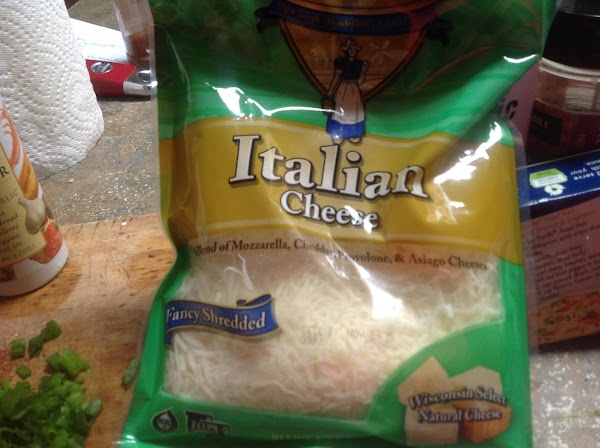 Now add in the shredded Italian Cheese and diced mini sweet peppers & half...