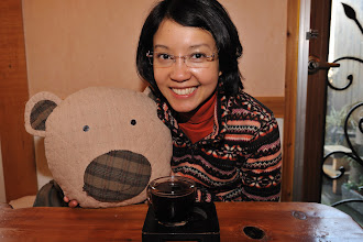 Photo: As for Cynthia, she has ordered a Korean sweet tea, that came with a bear (kidding).