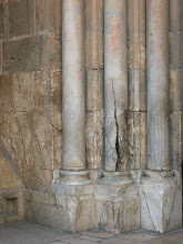 Photo: This is the column outside the entrance to the Church of the Holy Resurrection where the Holy Fire came out on Pascha when the Armenians had locked the Orthodox outside of the church. The Holy Fire came from this column and lit the candle of the Orthodox patriarch who was standing outside with the faithful.
