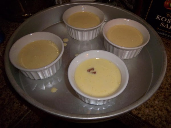 Ladle the custard into your ramekins over the apples. Some of the smaller chunks...