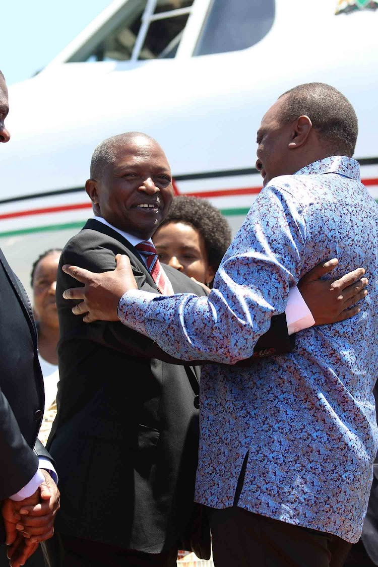 ANC deputy president David Mabuza welcomes Kenya's President Uhuru Kenyatta at the East London Airport.