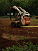 Photo: This is the machine that is making the holes so the stakes are secure in the ground.