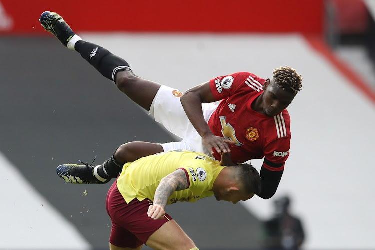 Manchester United's Paul Pogba in action with Burnley's Josh Brownhill.
