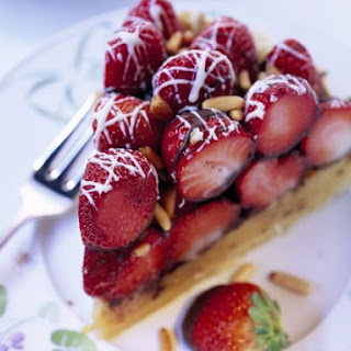 Slice of Fruit Tart with Chocolate Drizzle.