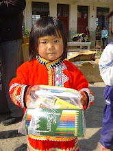 Photo: A little girl who just received her health packet