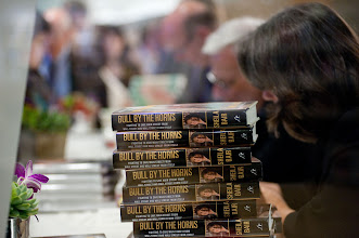 """Photo: Sheila Bair signs copies of her book, """"Bull by the Horns: Fighting to Save Main Street from Wall Street and Wall Street from Itself,"""" at the RAND Politics Aside event in Santa Monica, Calif. The event was Nov. 15-17, 2012 at the RAND headquarters campus."""