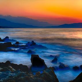 Misty sunset! by Stavros Troullinos - Landscapes Sunsets & Sunrises ( hdr, sunset, long exposure, beach, rocks, golden, , #GARYFONGDRAMATICLIGHT, #WTFBOBDAVIS )